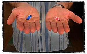 Two hands, holding a blue pill and a red pill